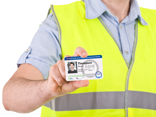 ASHE worker holding ID